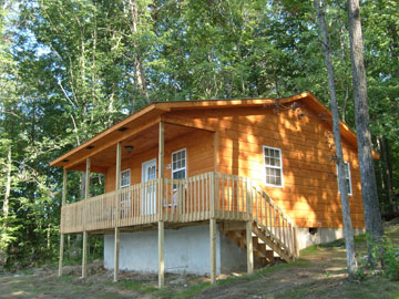 two bedroom rental cabin setting aside a private 185 acre